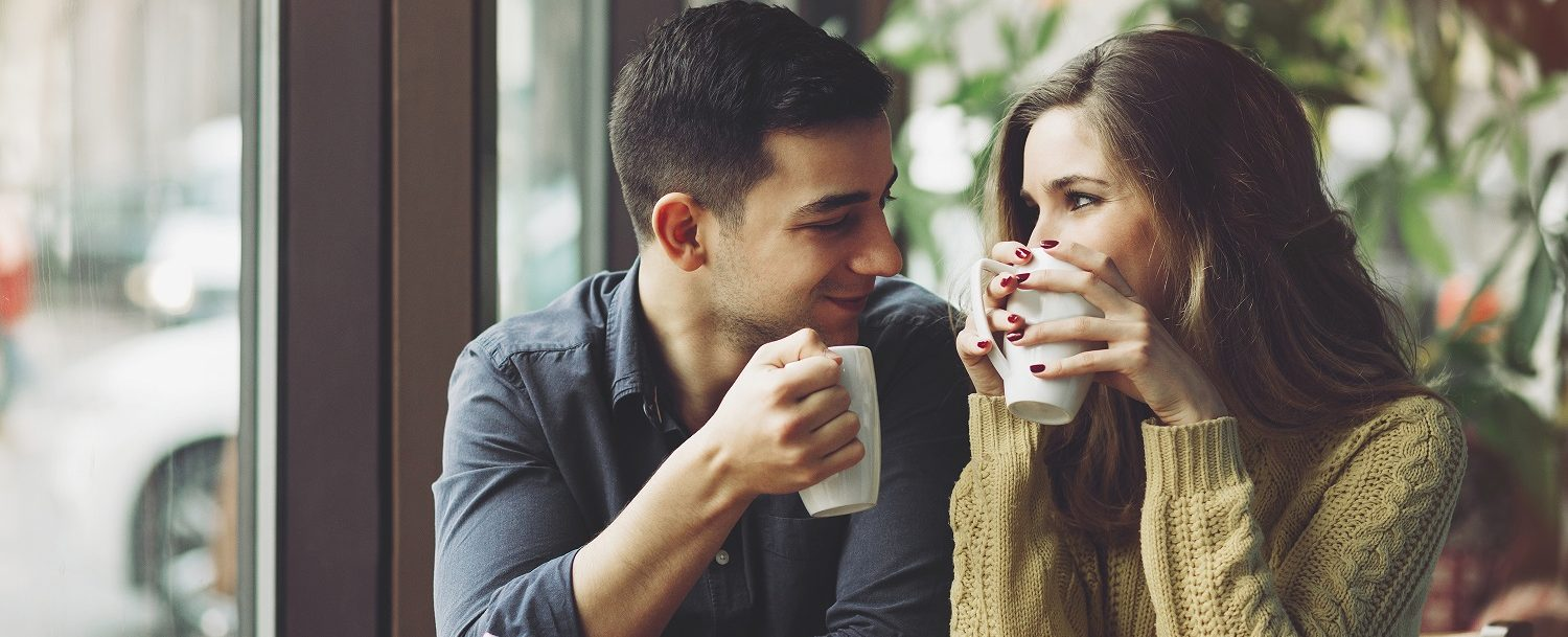 Couple drinking a cup of coffee | Things to do in Zionsville IN
