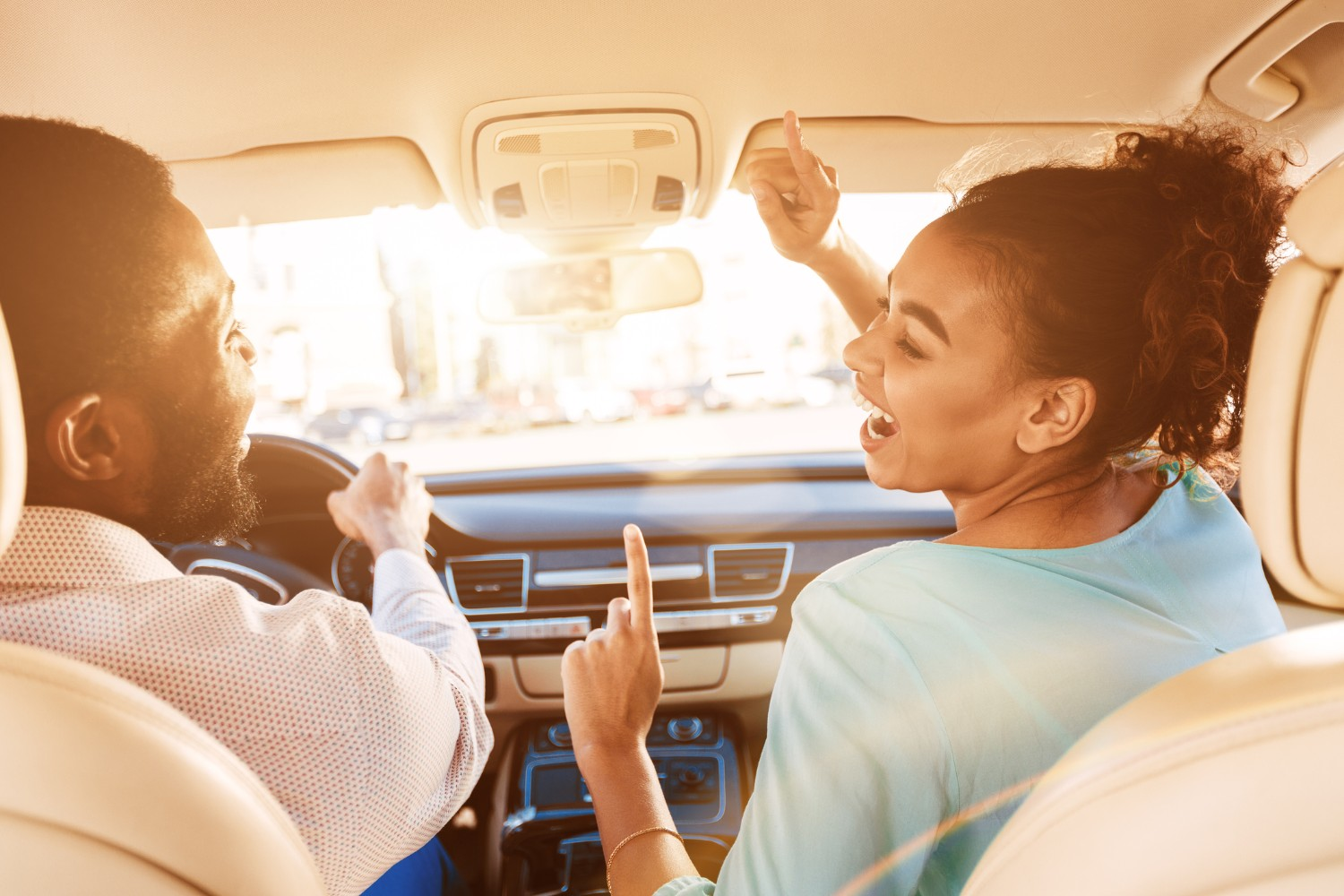 Couple enjoying karaoke in their car while on a road trip from Indianapolis to Zionsville, IN