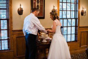 Wedding Couple Cutting Cake at the Brick Street Inn