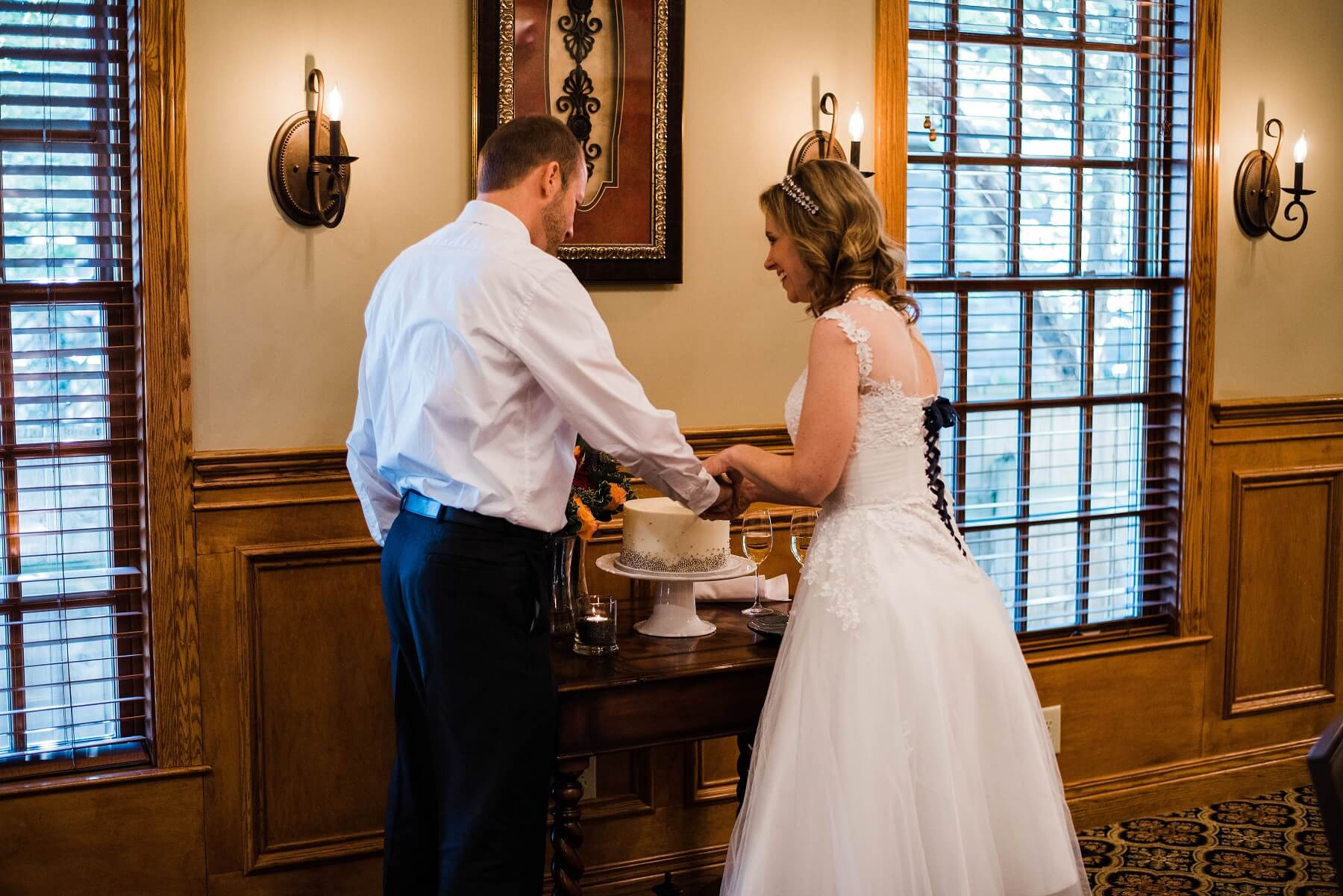 Wedding Couple Cutting Cake at the Brick Street Inn