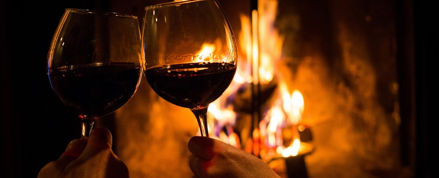 Romantic getaway near indianapolis | couples drinking wine by the fire